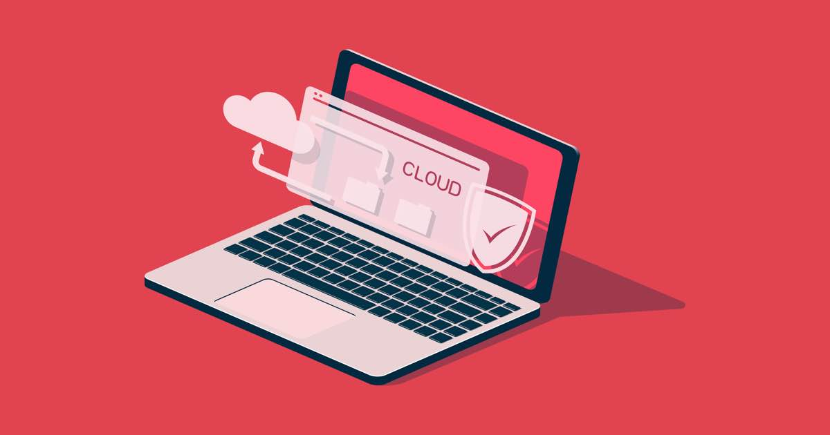 Ordenador portátil abierto con símbolo de seguridad y nube en la pantalla